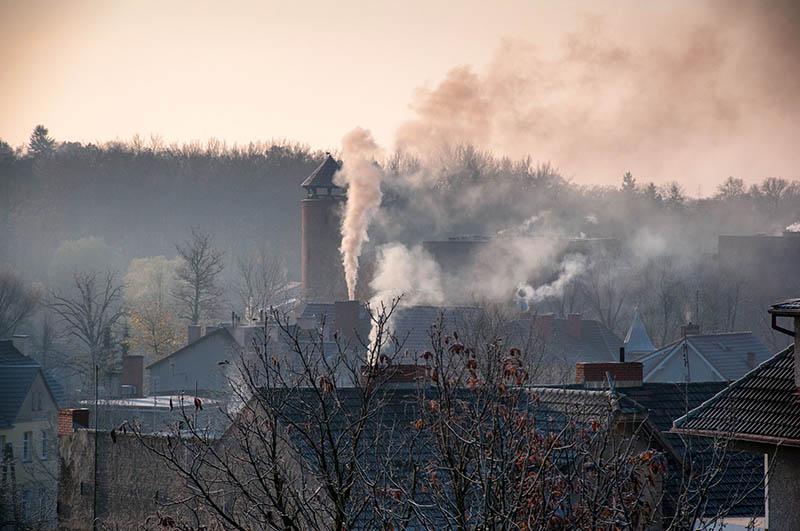 67189331 - smoking chimneys in city